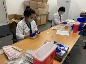 Medical Professionals preparing vaccines